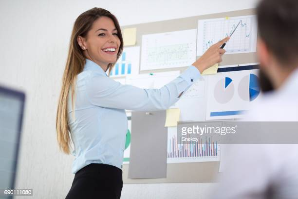 Business woman investment consultant analyzing company seal report balance sheet statement working with documents on laptop