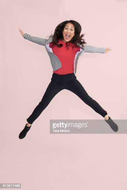 business woman jumping - skinny pants stock pictures, royalty-free photos & images