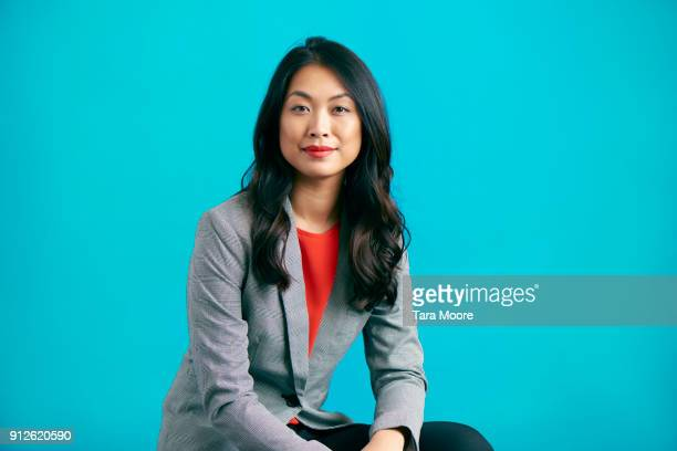 business woman jumping - formal portrait stock pictures, royalty-free photos & images
