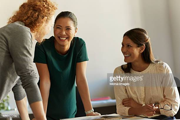 Business woman laughing during meeting