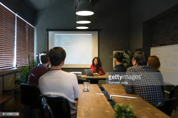 Business woman leading presentation in office