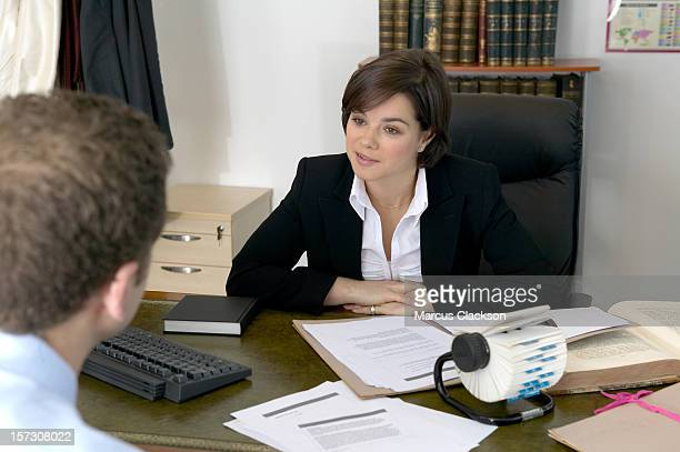 Business Woman listening in a meeting
