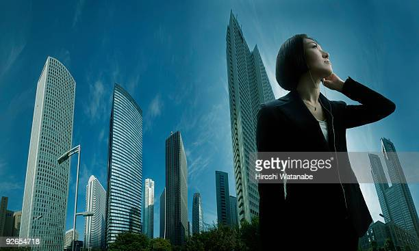 Business woman listening to potable music player