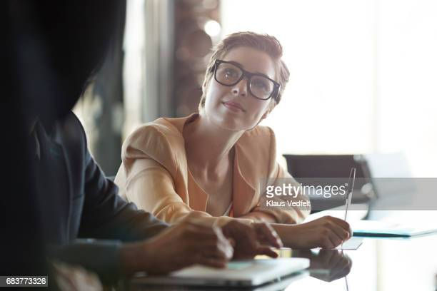 Business woman listening, when co-worker presenting project