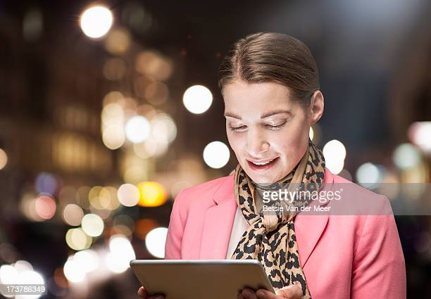 Business woman looking at handheld computer