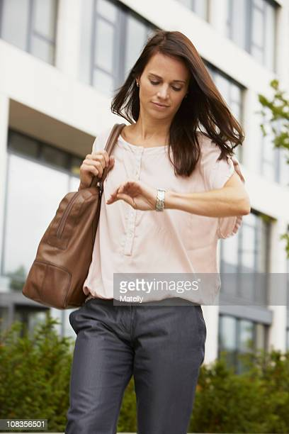 Business woman looking at watch