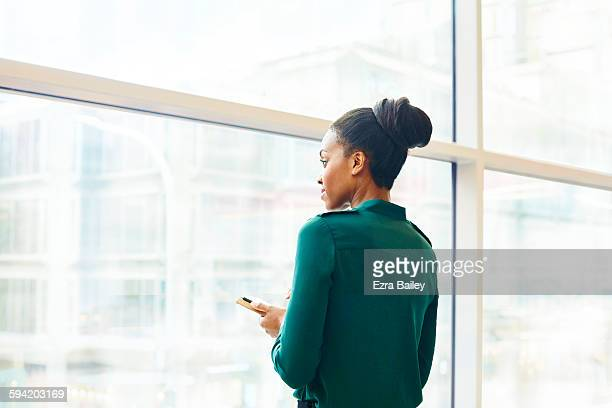 Business woman looking out over the city.