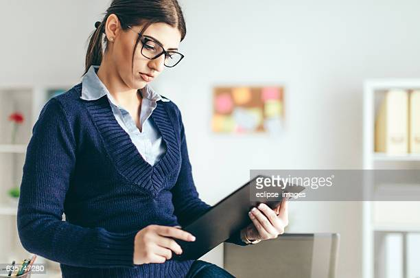 Business woman looking over papers