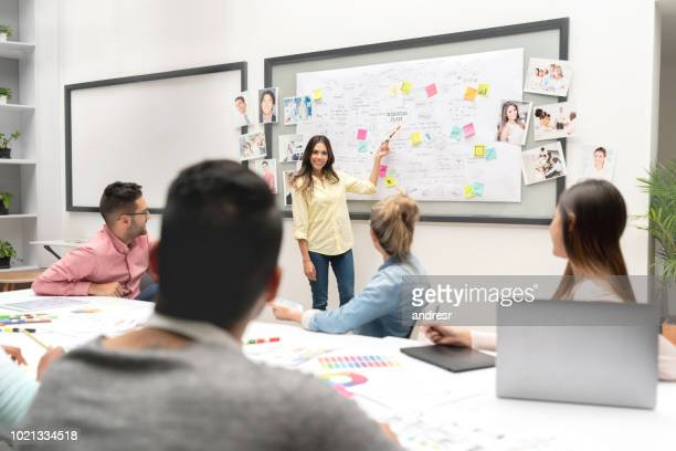 Business woman making a presentation at a creative office