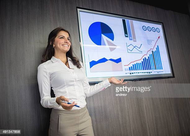 business woman making a presentation - pie chart stock pictures, royalty-free photos & images