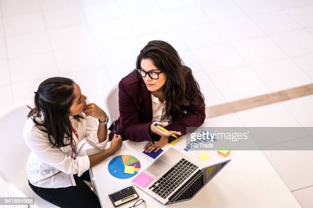business woman meeting - accounting stock photos and pictures