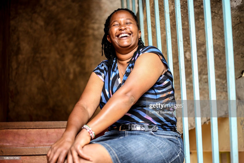 Woman laughing happily outdoors