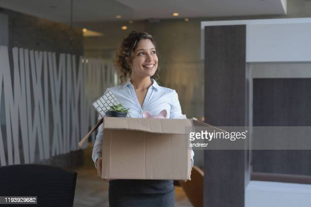 business woman moving into a new office - quitting a job stock pictures, royalty-free photos & images