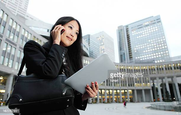 Business woman on cellphone in Tokyo, Japan