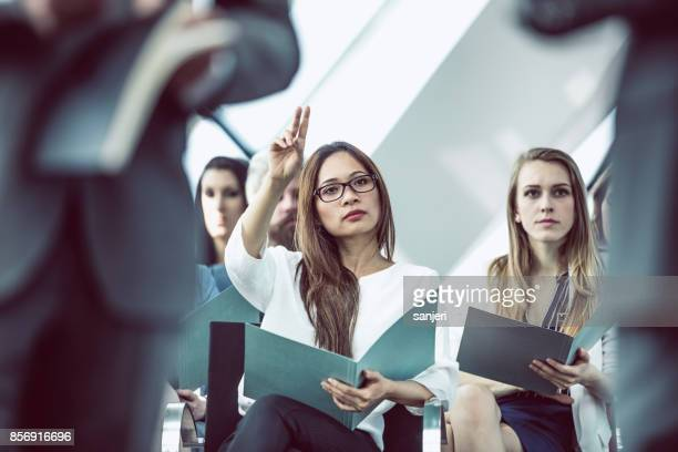 Business Woman on Conference Event Asking Questions