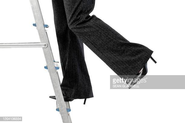 business woman on step ladder - formal businesswear stock pictures, royalty-free photos & images