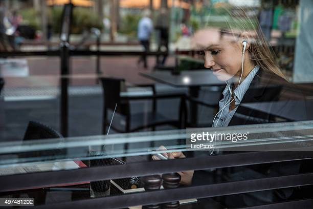 Business woman on the window of a cafe