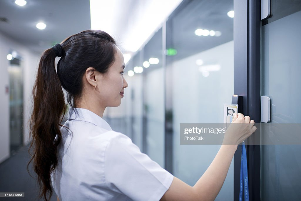 Business Woman Open The Office Door - XXXXXLarge : Stock Photo