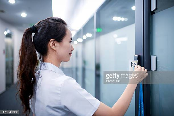 business woman open the office door - xxxxxlarge - security stock pictures, royalty-free photos & images