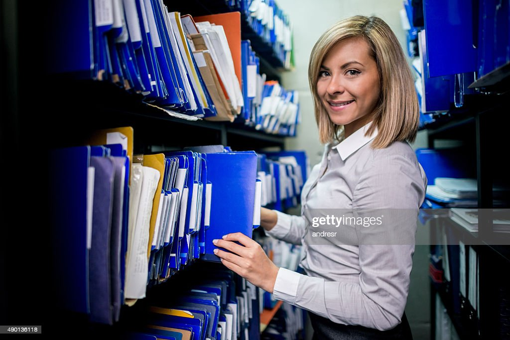 Business woman organising the files : Stock Photo