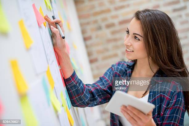 Business woman organizing ideas