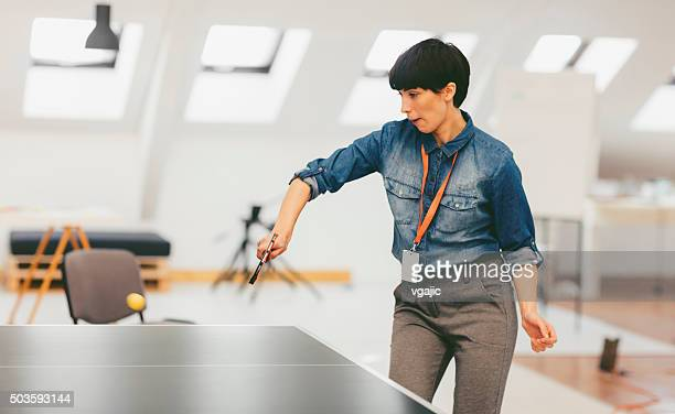Business Woman Playing Table Tennis In Her Office