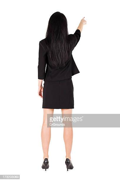 Business woman pointing turned backwards isolated