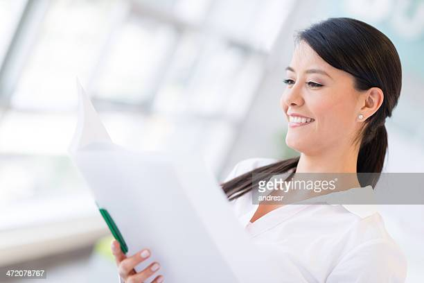 Business woman reading documents