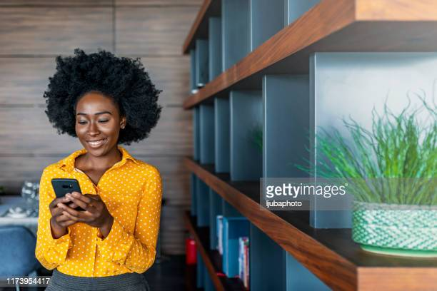 business woman reading text message on mobile phone - examining stock pictures, royalty-free photos & images