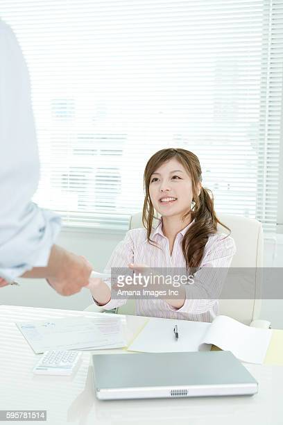 A business woman receiving documents