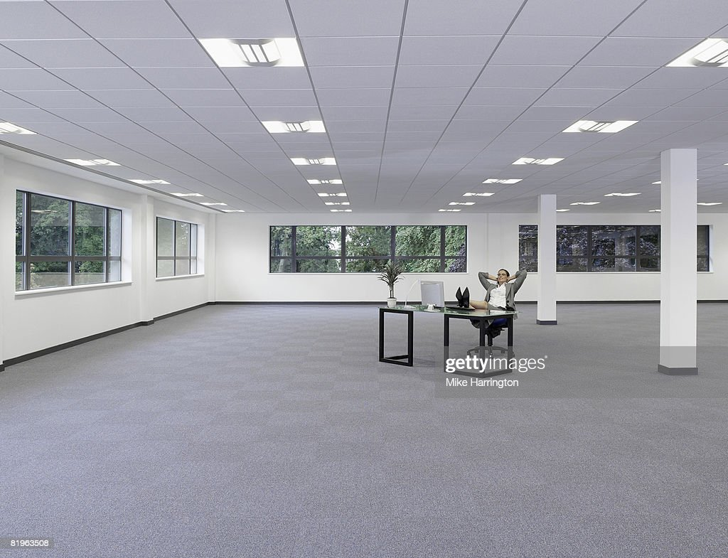large office space. Business Woman Relaxing At Desk In Large Empty Office Space : Stock Photo