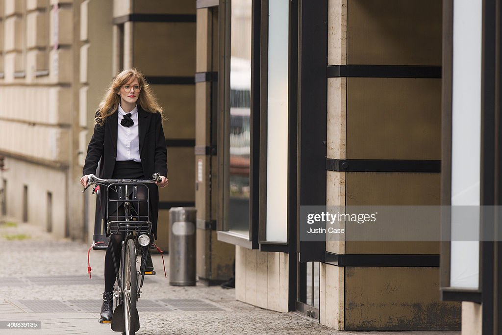 business woman riding a bike in the city : Stock Photo