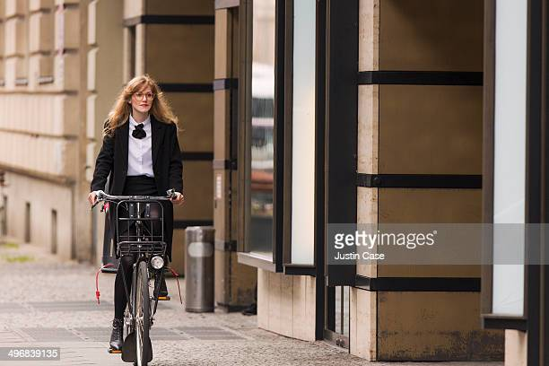 business woman riding a bike in the city