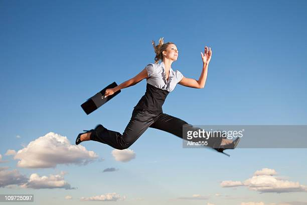 Business woman running through the air
