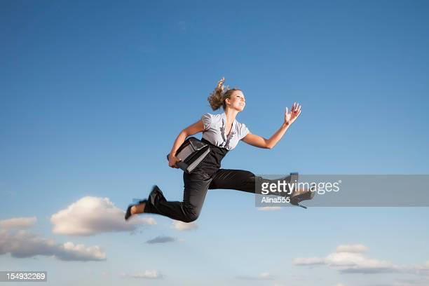 Business woman running through the air