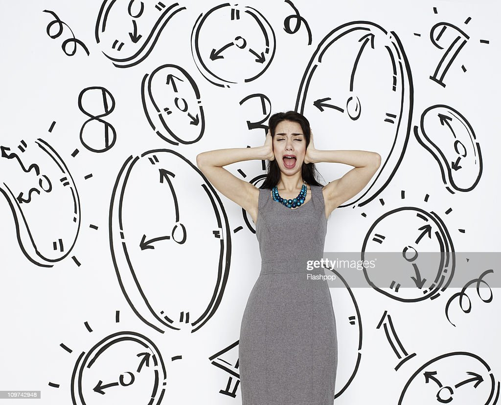 Business woman screaming, surrounded by clocks : Stock Photo