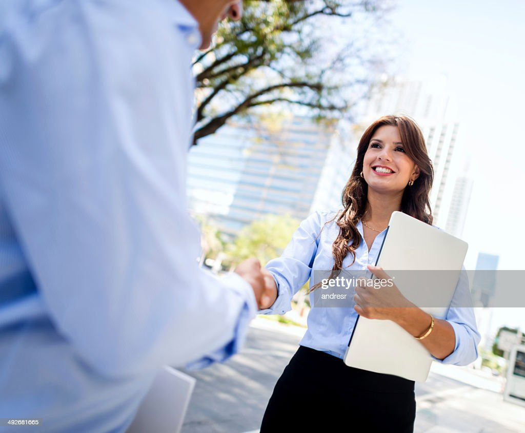 Business woman shaking hands : Stock Photo