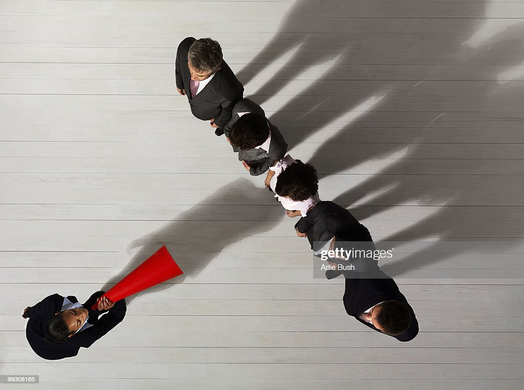Business woman shouting at colleges : Stock Photo