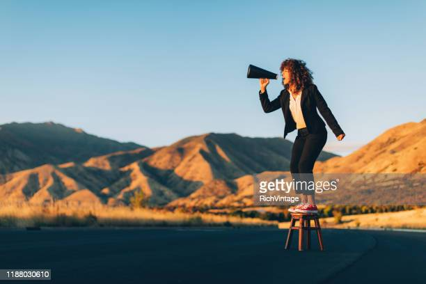business woman shouting through megaphone - megaphone stock pictures, royalty-free photos & images