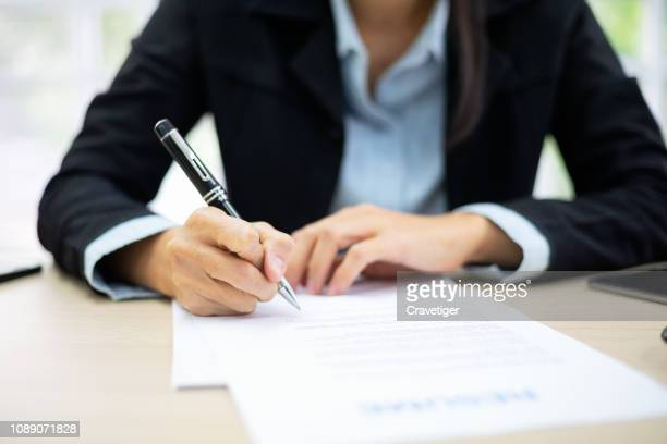 business woman signing documents . deal concept. - parte do corpo humano imagens e fotografias de stock