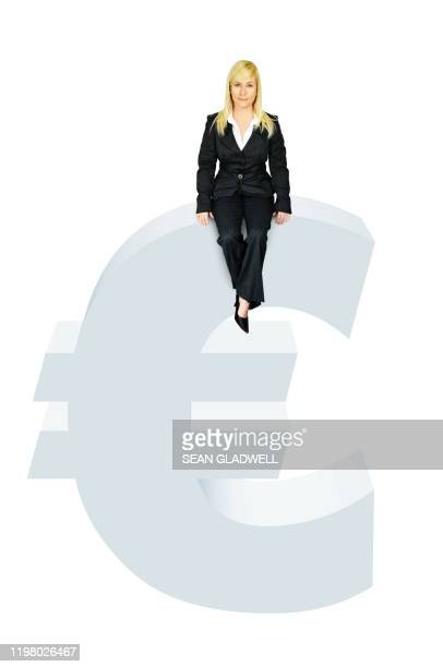 business woman sitting on euro symbol - graphic accident photos stock pictures, royalty-free photos & images
