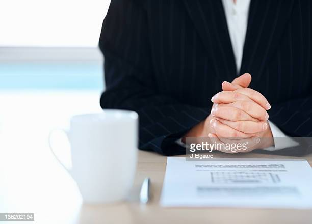 Business woman sitting with a form at table