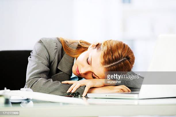 Business woman sleeping at work