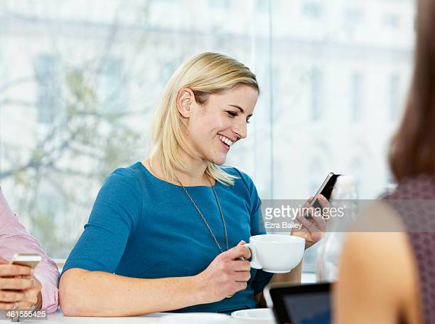 Business woman smiling at her mobile phone