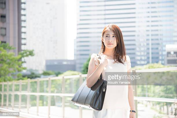 Business woman smiling in city location