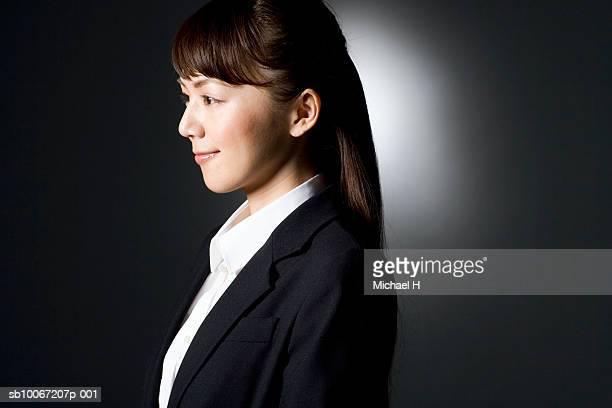 business woman smiling, studio shot - 大人のみ ストックフォトと画像