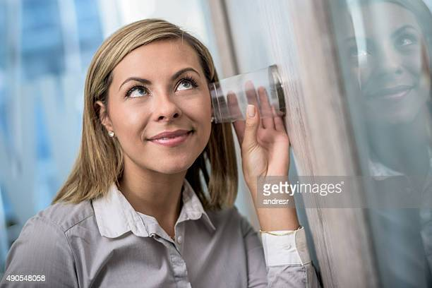 Business woman spying at the office