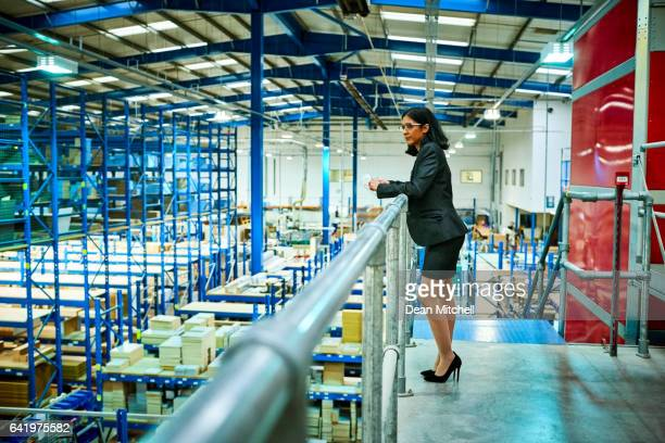 Business woman standing in factory balcony