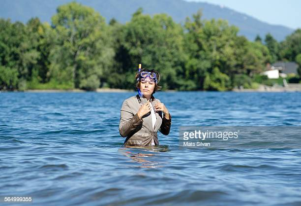 business woman standing in water - waist deep in water stock pictures, royalty-free photos & images