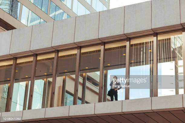 business woman standing on pedestrian bridge - elevated walkway stock pictures, royalty-free photos & images